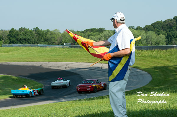 Corner Worker With Flags At Grattan Raceway In Michigan. Fine Art Motorsports Photography.