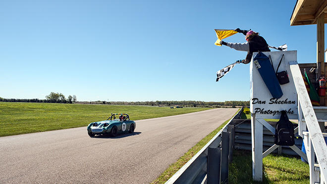 Bugeye Sprite Vintage Sports Car Gets The Checkered Flag At Gingerman Raceway In South Haven, Michigan.