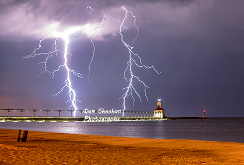 Double Lightning Strikes Over The Michigan City, Indiana Lighthouse. The Great Lakes Are Famous For Extreme Weather Photo Opportunities. Dan Sheehan Photographs