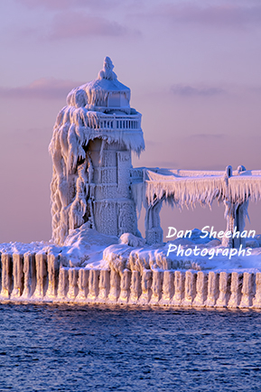 St. Joseph, Michigan Lighthouse With Heavy Coat Of Snow And Ice After Sunset. Extreme Wind Storms Over The Great Lakes Create Huge Waves Which Crash Into The Lighthouses And Freeze Almost Instantly. Dan Sheehan Photographs