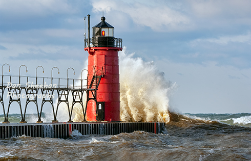 The South Haven, Michigan Lighthouse With Large Wave Driven By Gale Force Winds Crashing Into It. www.BlackWindSix.com