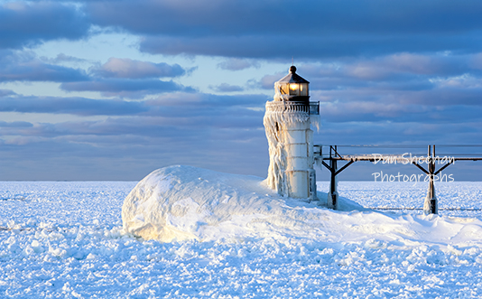 The St. Joseph, Michigan Outer Lighthouse Photographed With A Thick Coating Of Snow And Ice. Lake Michigan Is Frozen Solid. www.BlackWindSix.com
